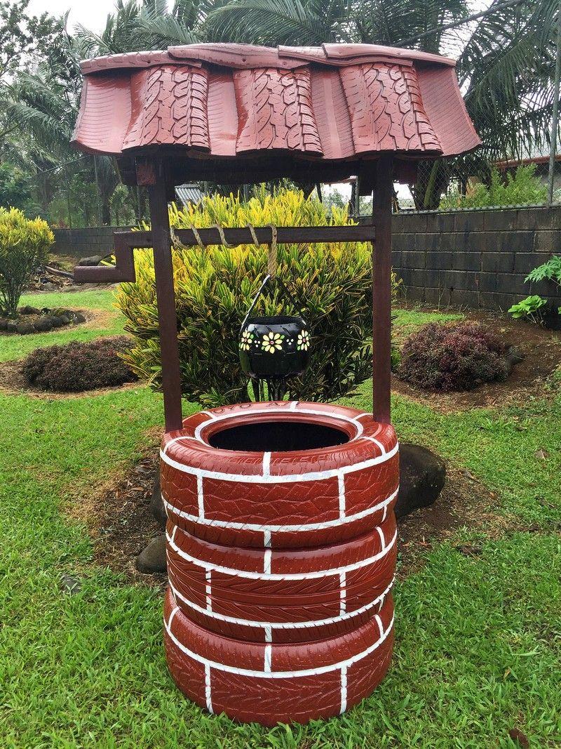 Декоративный колодец для сада из старых автомобильных шин